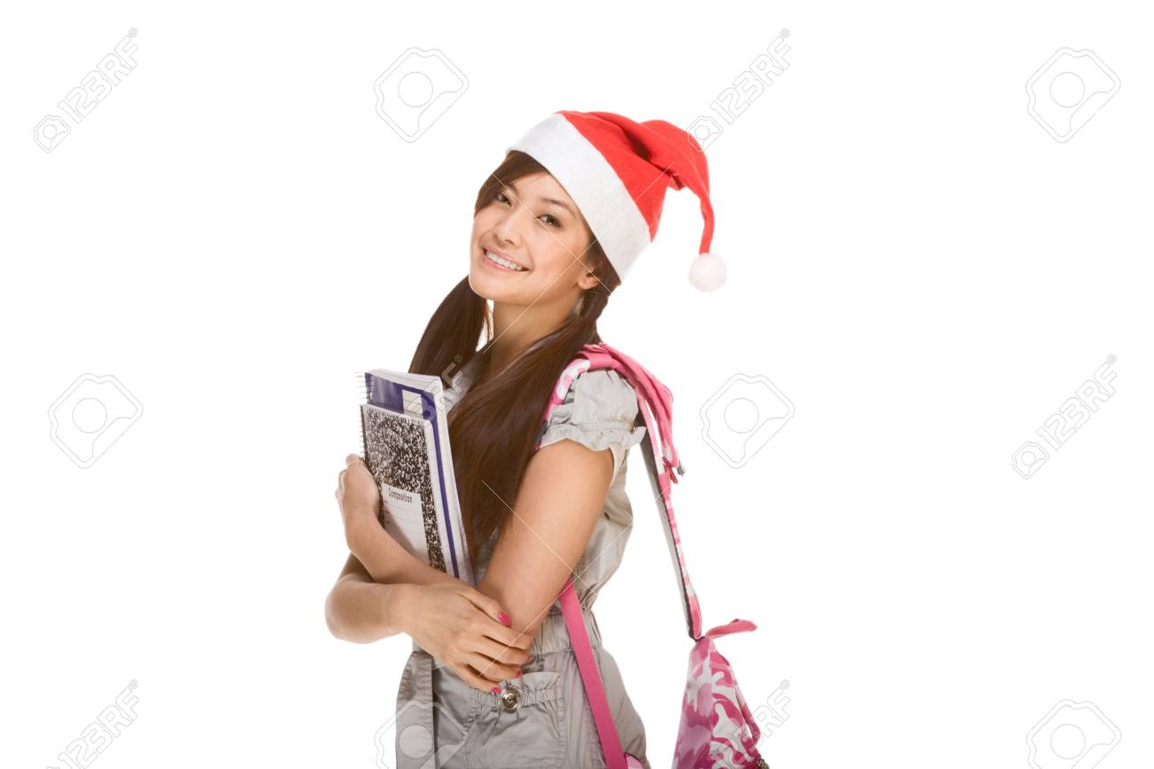 Asian schoolgirl wearing red Santa Claus hat with backpack holding Composition book, notebooks and pen Stock Photo - 3869685