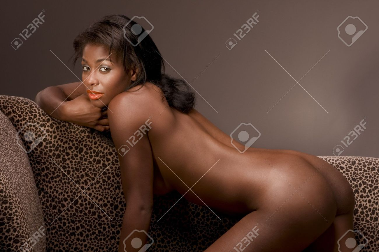 African American Hot Nude Woman On Couch In Sensual Erotic Seductive Pose Demonstrating Her Perfectly