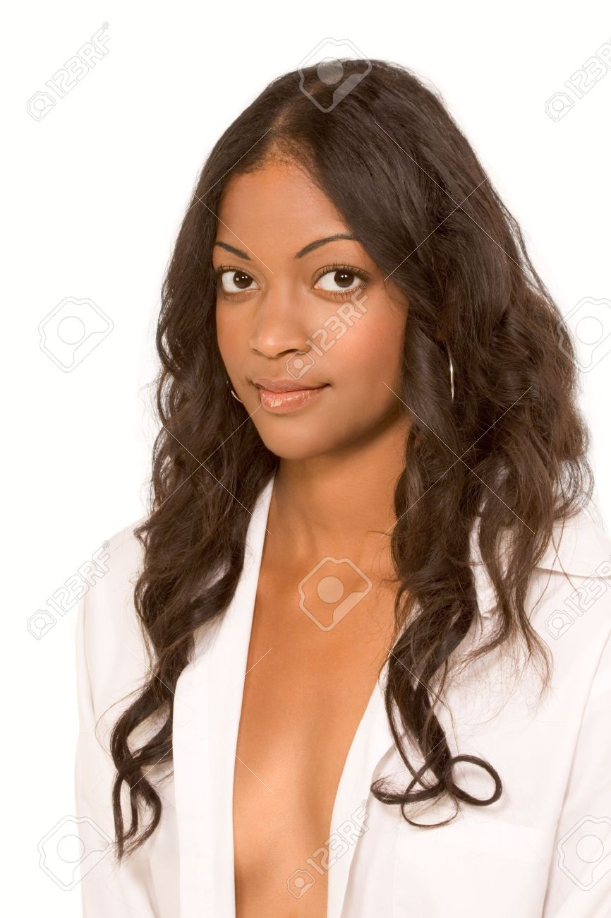 Beautiful mulatto dark skinned girl with long hair and big eyes in white shirt. The top is open and cleavage is revealed Stock Photo - 4366343