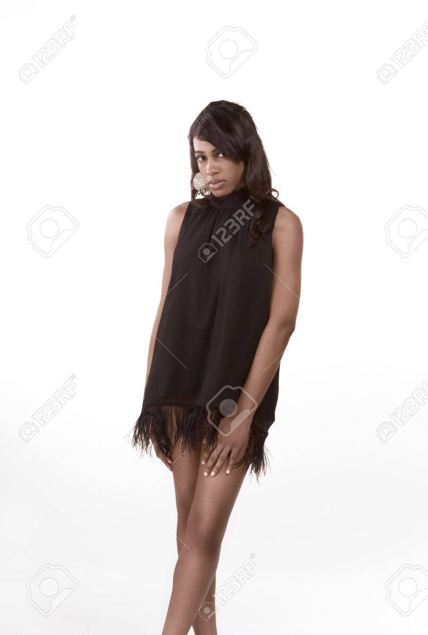 Portrait of a beautiful black African American female with long legs in black dress Stock Photo - 4638264