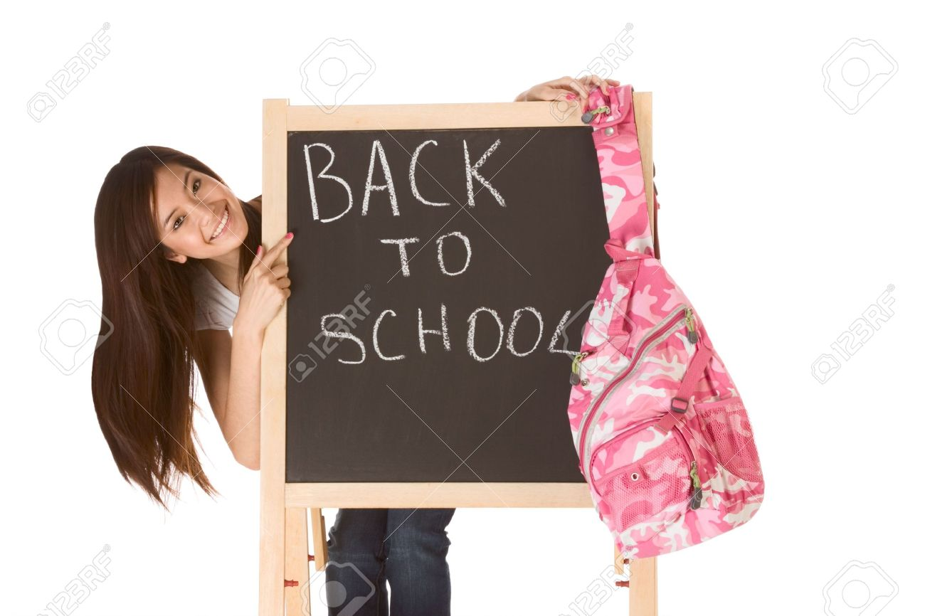 Friendly young ethnic High school girl student of mixed Vietnamese and Chinese race standing by chalkboard with hanging backpack and pointing to the text - back to school Stock Photo - 5257477