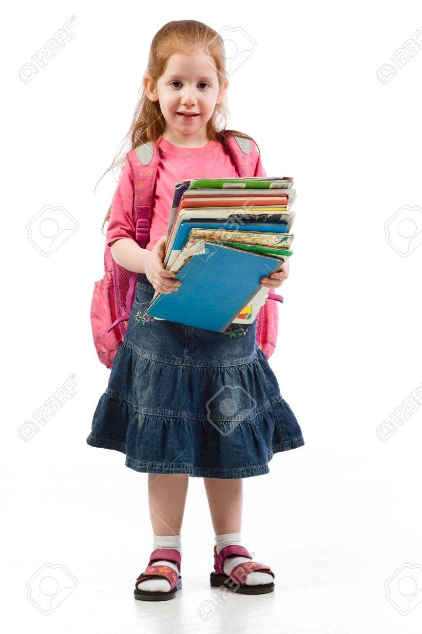 Young red head girl standing with huge pile of books in her hands and back pack, having very tiered facial expression Stock Photo - 5285856