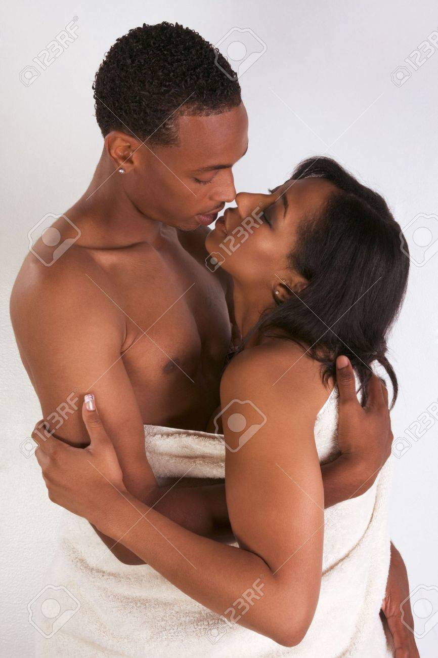 Black sensual couple, African American man and woman of Creole ethnicity hugging wrapped in bathtowel Stock Photo - 5458805