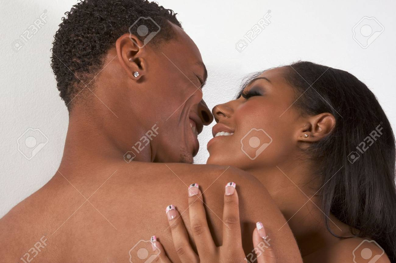 Loving ethnic black African-American young affectionate nude heterosexual couple in affectionate sensual kiss Stock Photo - 6025246