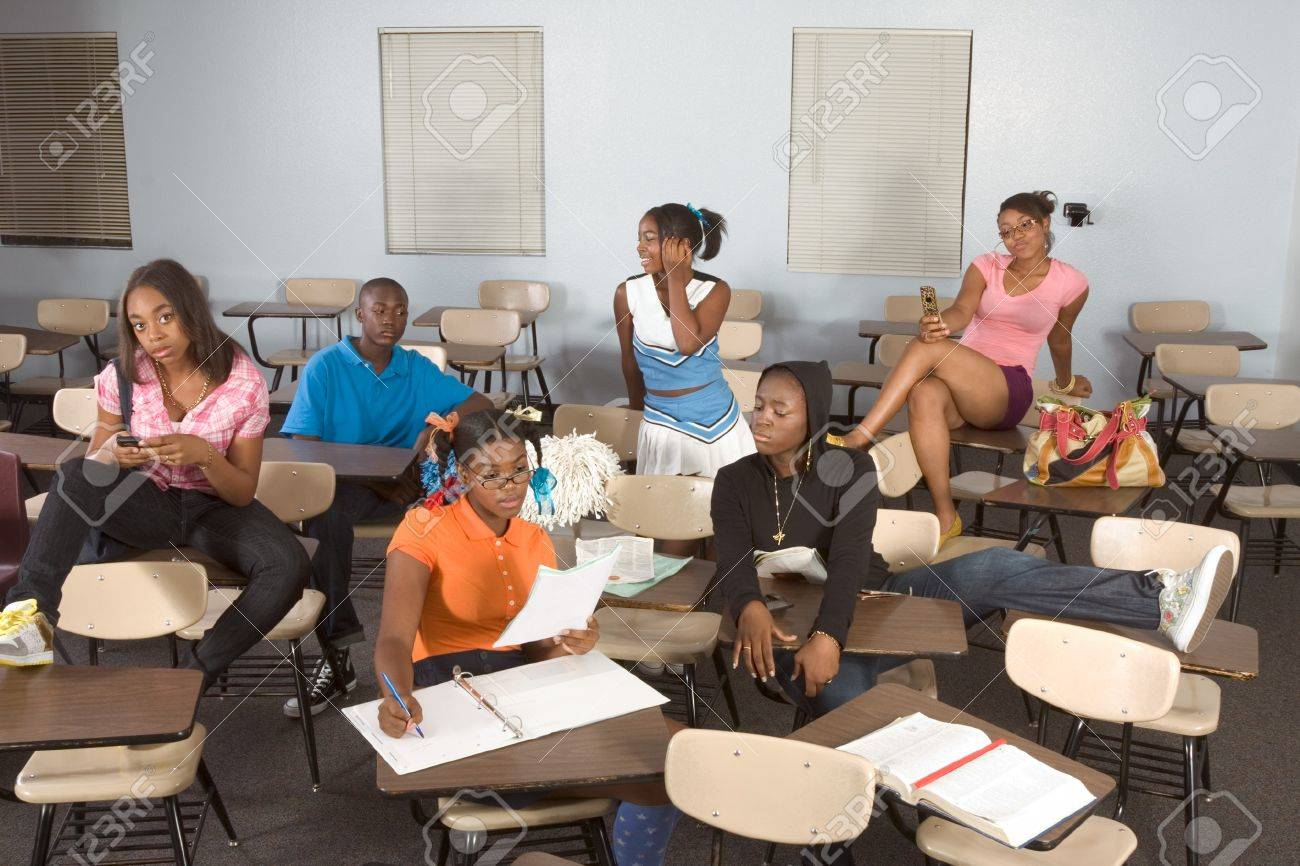 lassroom girls Stock Photo - High school classroom with six children, one boy and five girls, making chaos