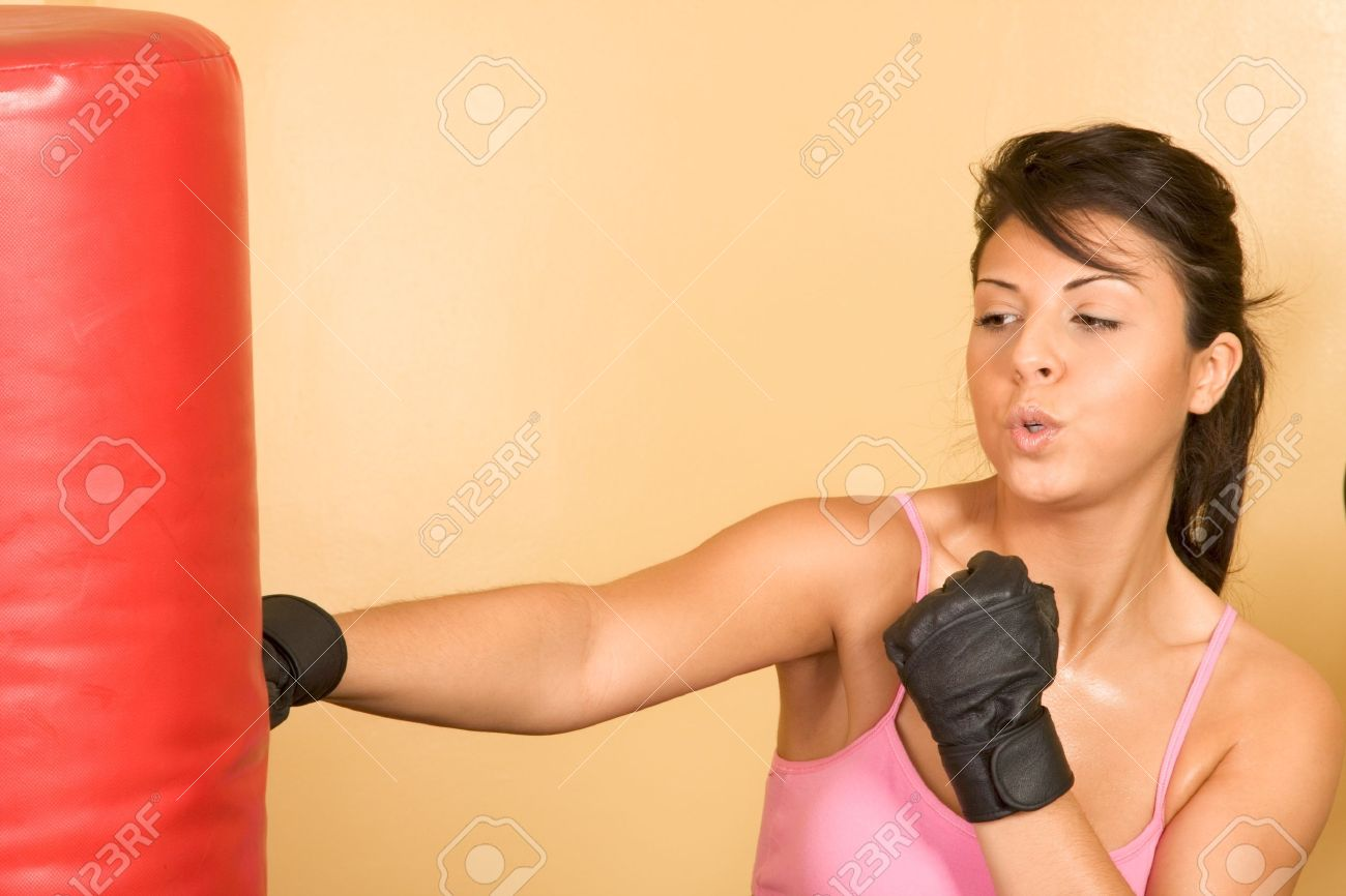 Attractive young female working out on weight-lifting training machine Stock Photo - 8145168