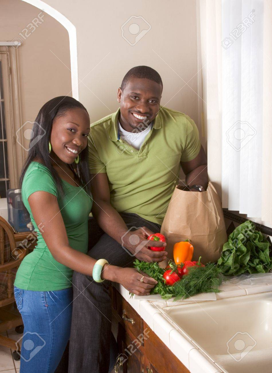 Young black African American couple sorting vegetable on kitchen countertop Stock Photo - 8145169