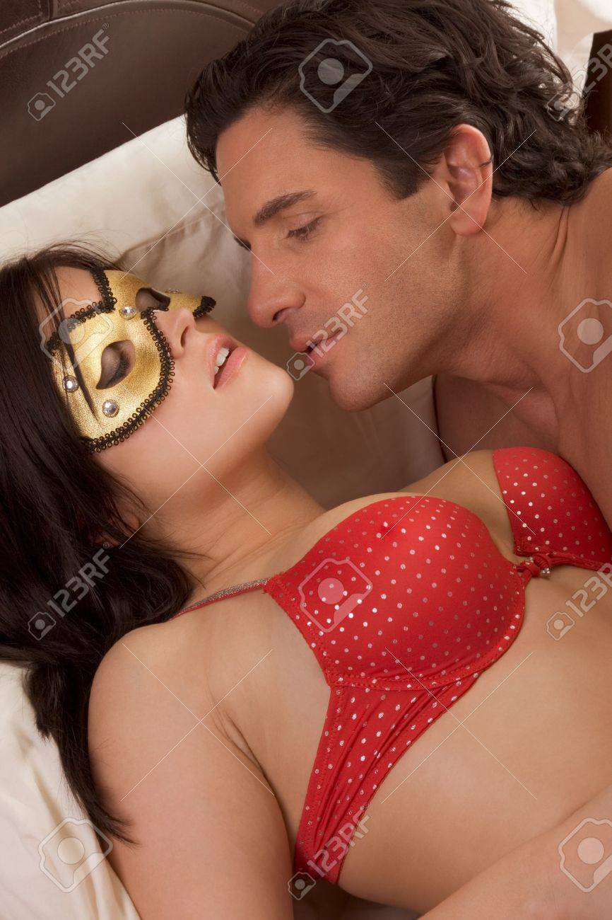 Seductive woman with man, wearing mystery fetish mask Stock Photo - 8340140