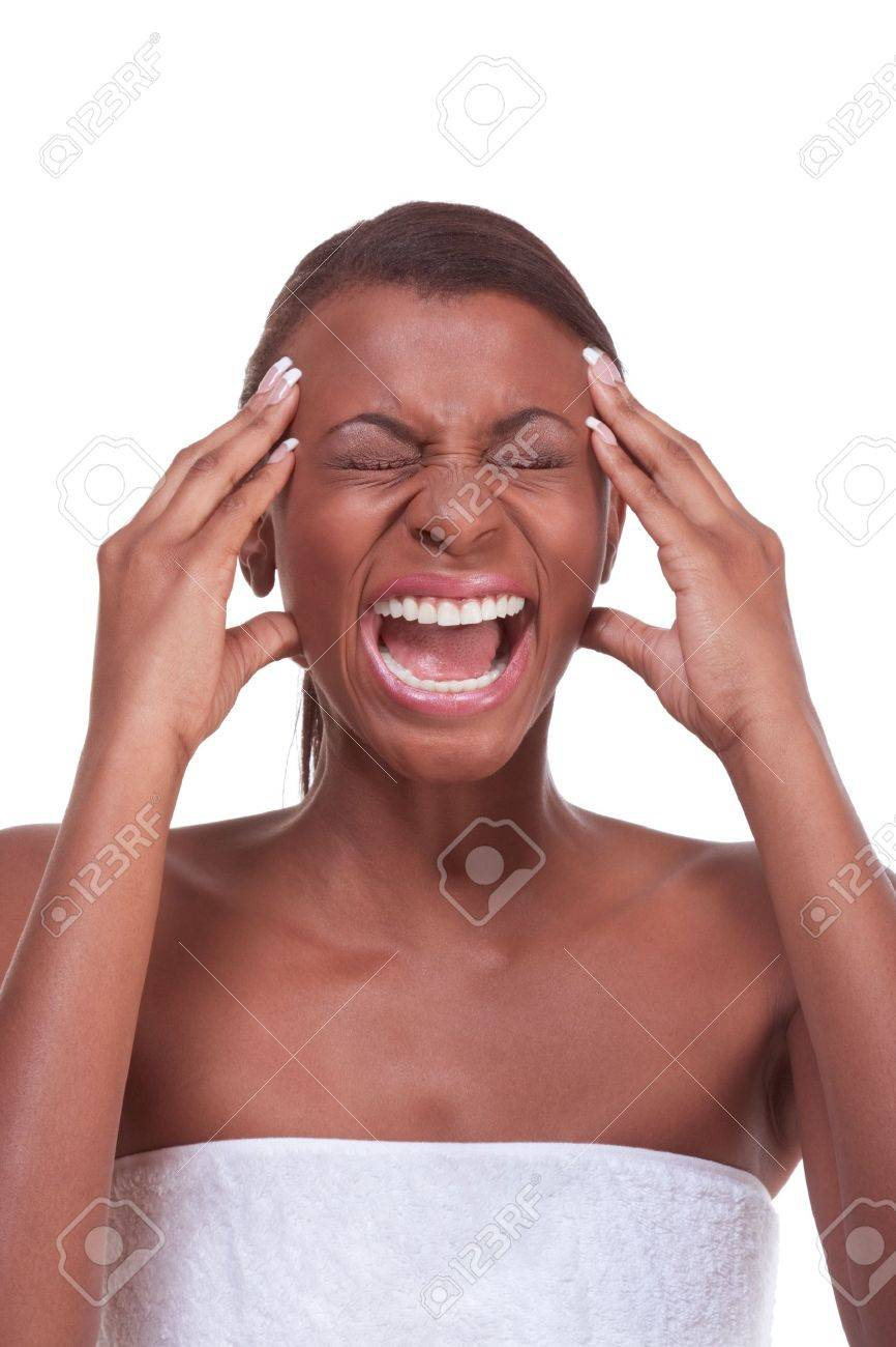 Portrait of female who is touching squeezing her head by hand and apparently suffering from severe migraine Stock Photo - 8407045