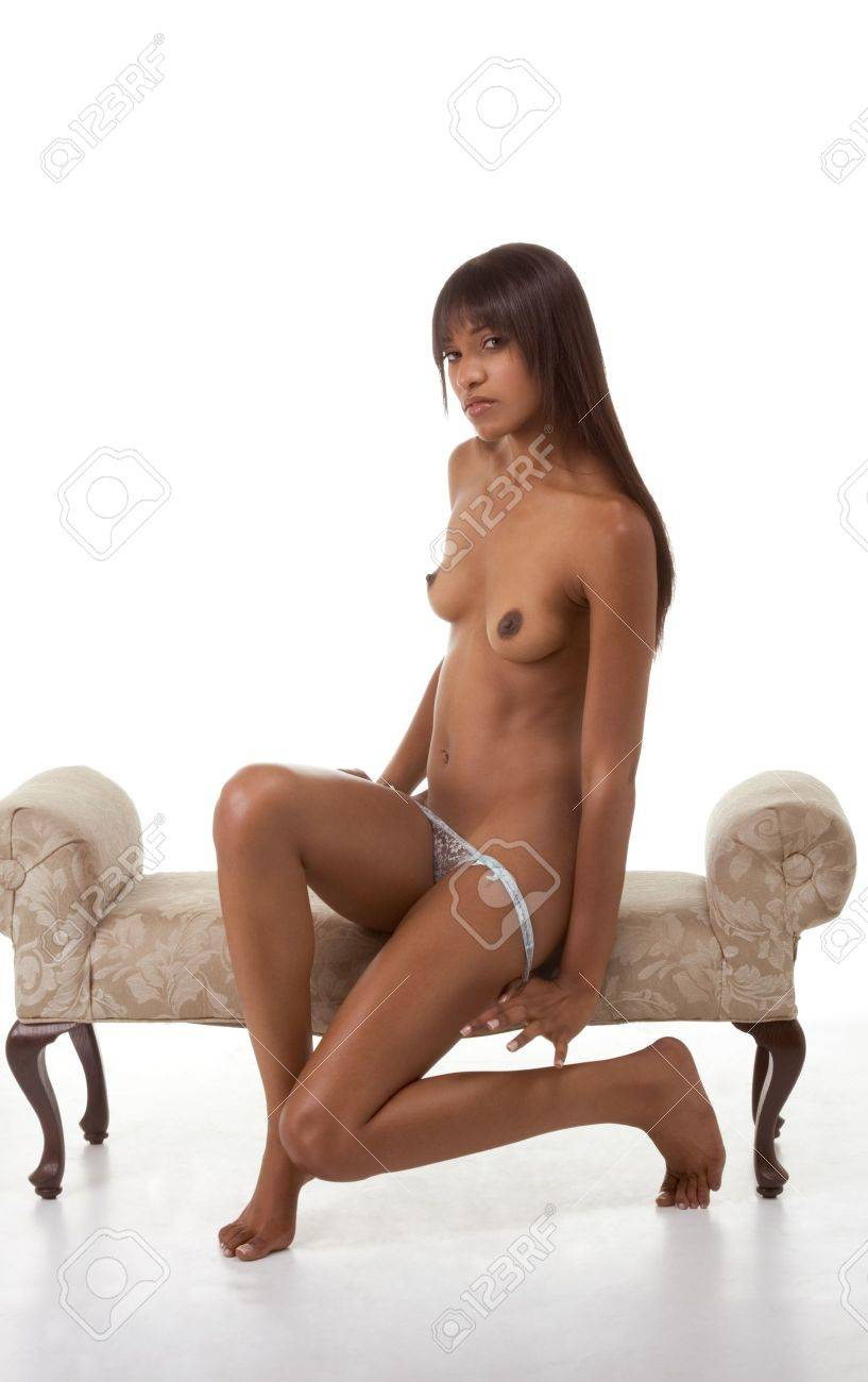 Sensual black ethnic biracial (mix of African-American, Caucasian and Native American ethnicity) woman stripper undressing Stock Photo - 8407041