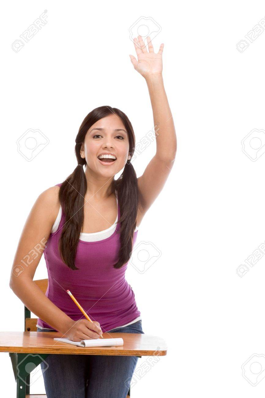High school or college female student sitting by the desk raising her arm signaling that she know and is ready to answer Stock Photo - 8768046