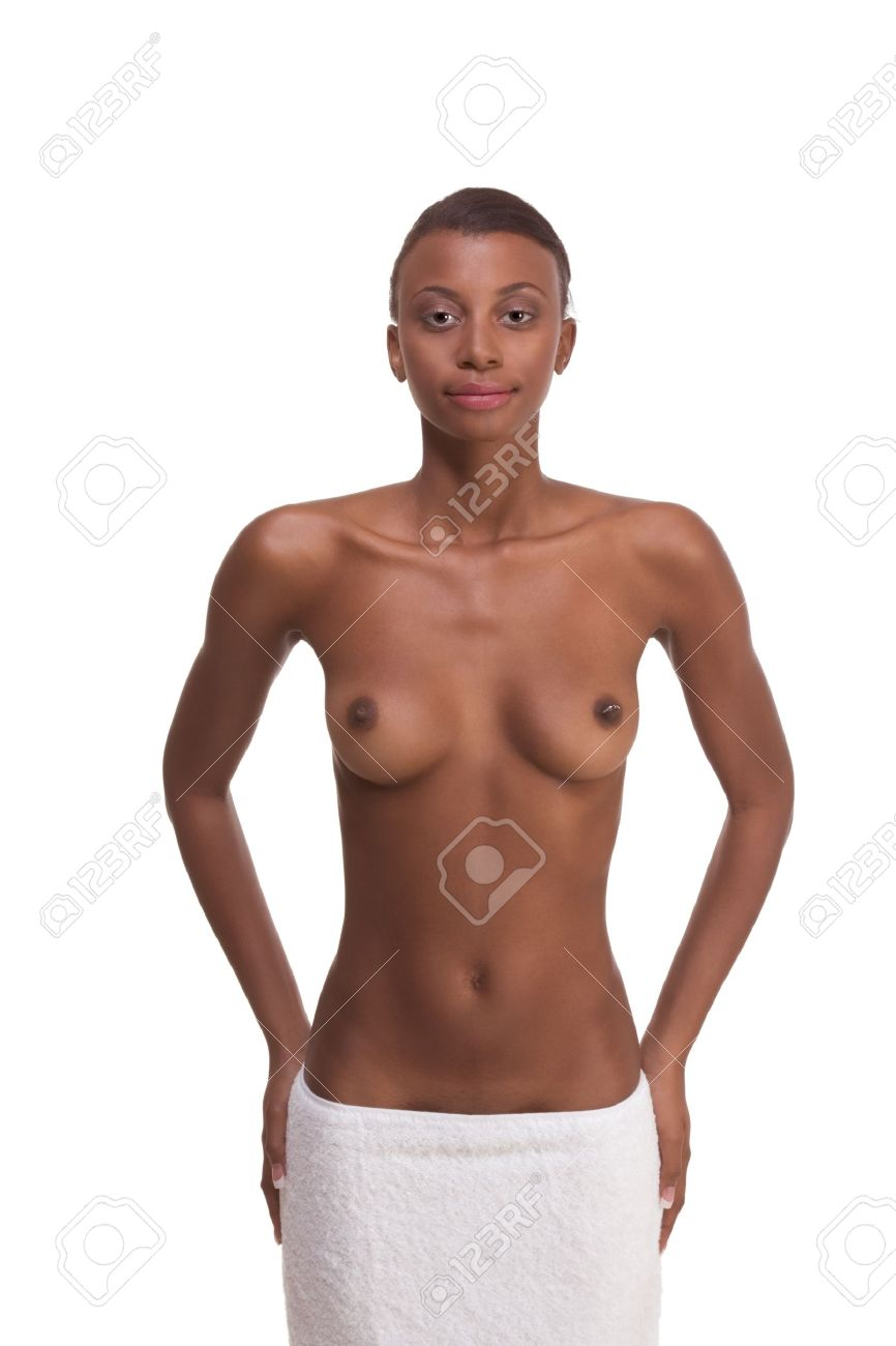 Young ethnic topless black female with slicked back hair wrapped in white bath towel around her hips after sauna Stock Photo - 9040623