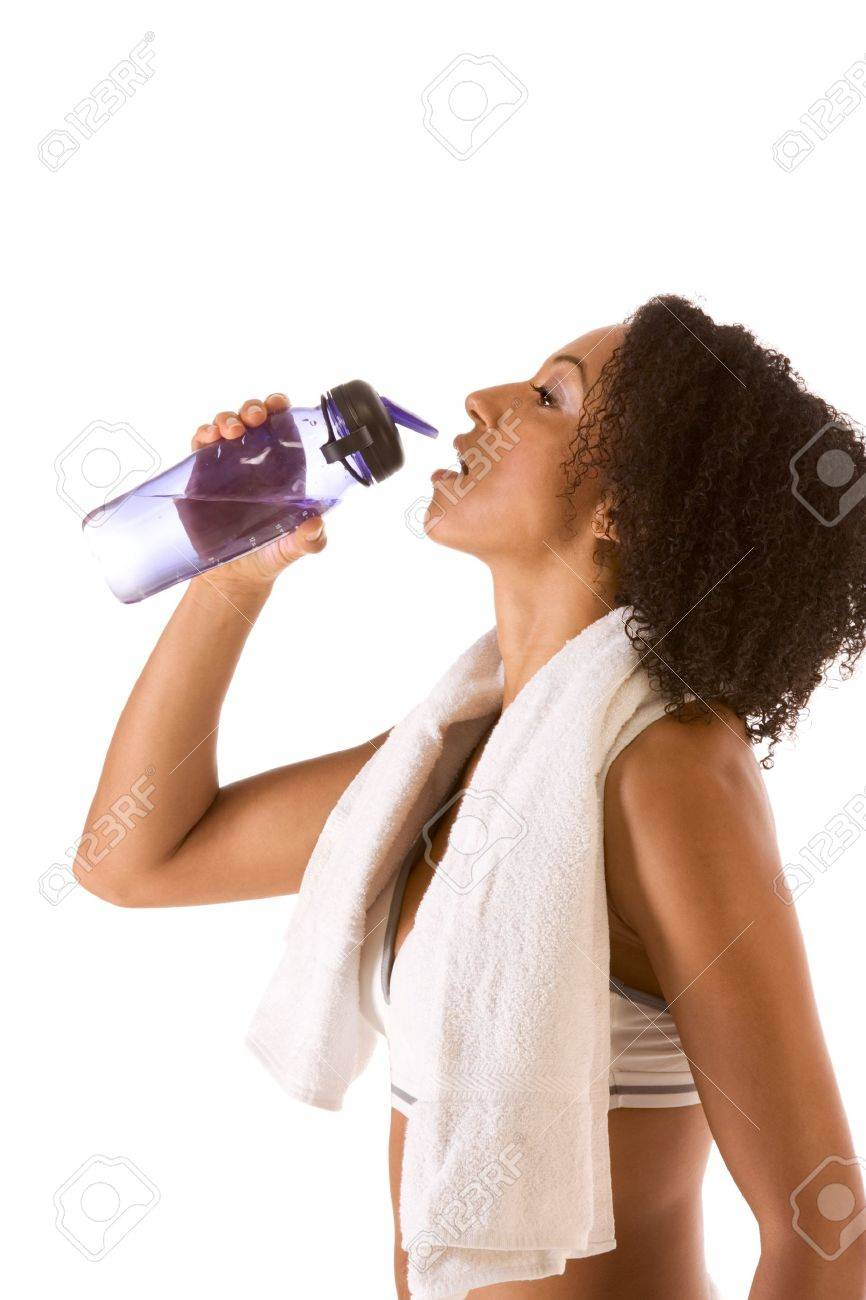 Dark skinned female in sporty outfit holding bottle of water Stock Photo - 10045882