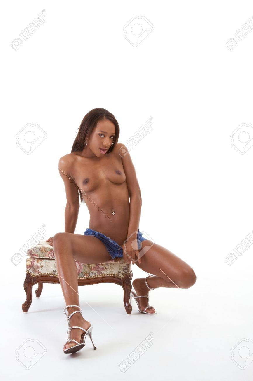 Young sexy ethnic black African-American woman in denim shorts Stock Photo - 10045790