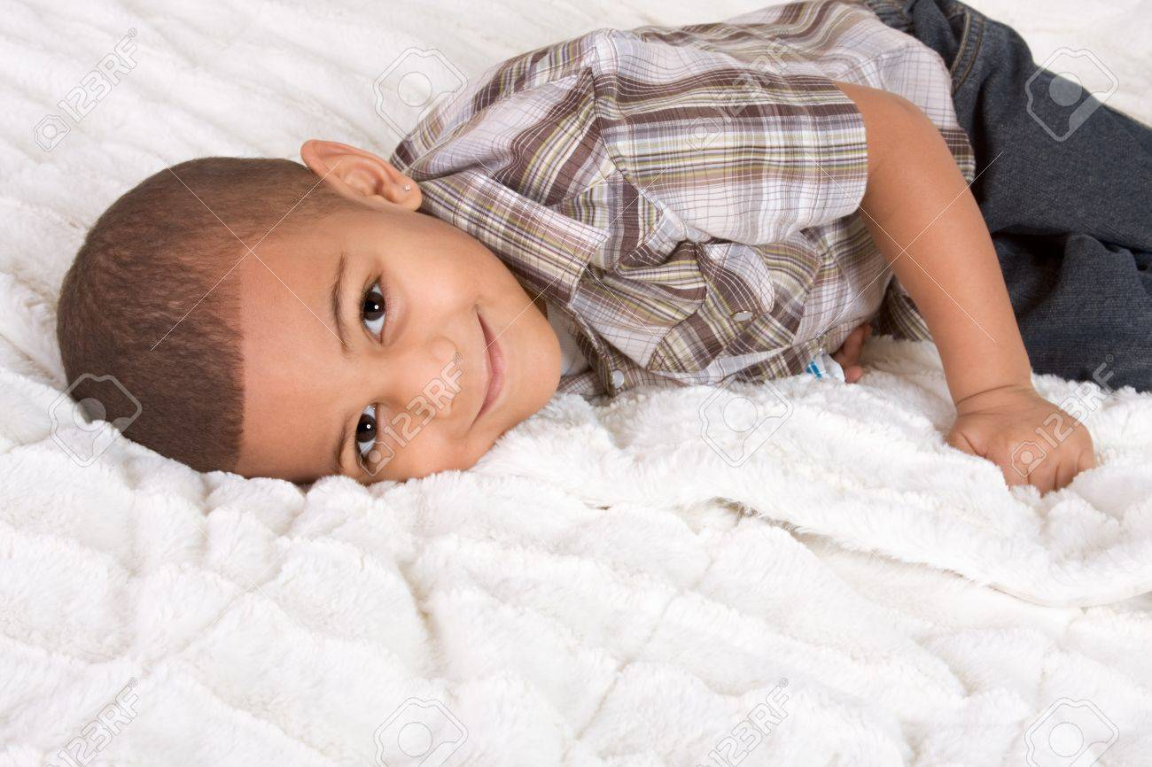 Young little boy on bed Stock Photo - 10119476