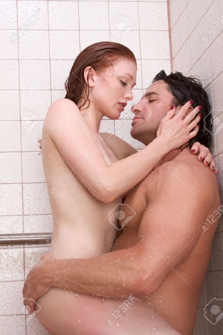 Loving affectionate nude young heterosexual couple in affectionate taking a shower Stock Photo - 10425821