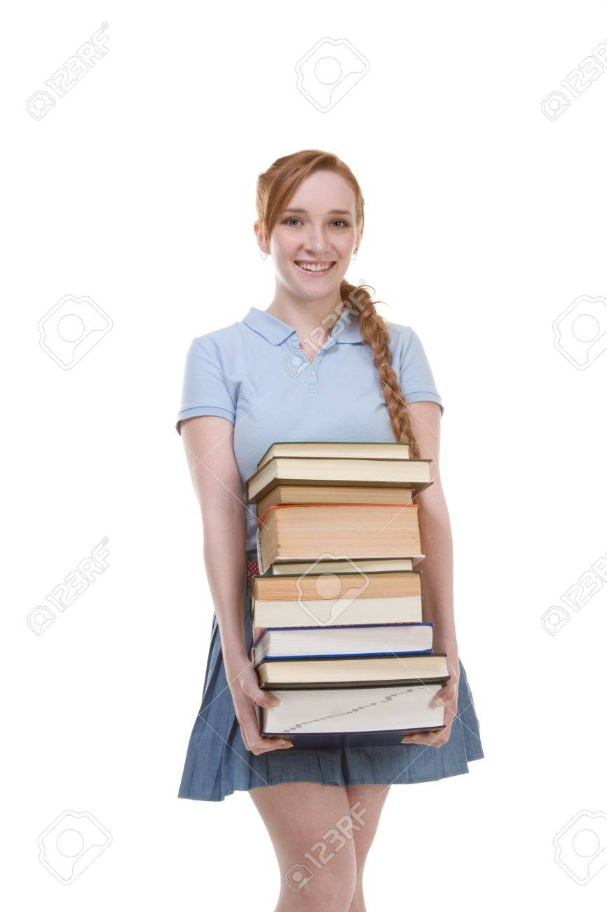 Young Caucasian female college student in jeans with backpack holding huge pile of educational books from library Stock Photo - 11209858