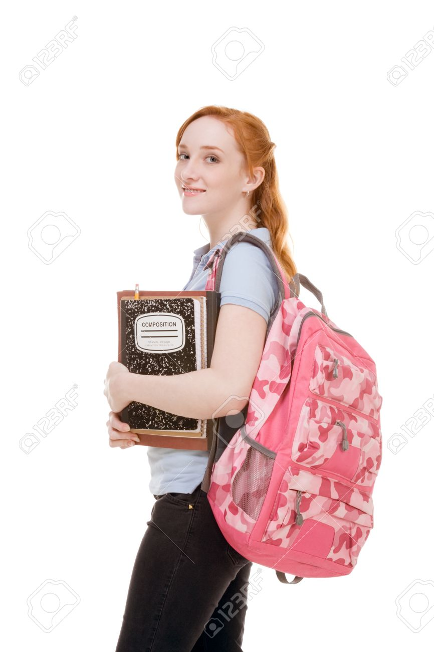 4fe061b4fe Friendly Caucasian High school girl student standing with backpack and  holding books