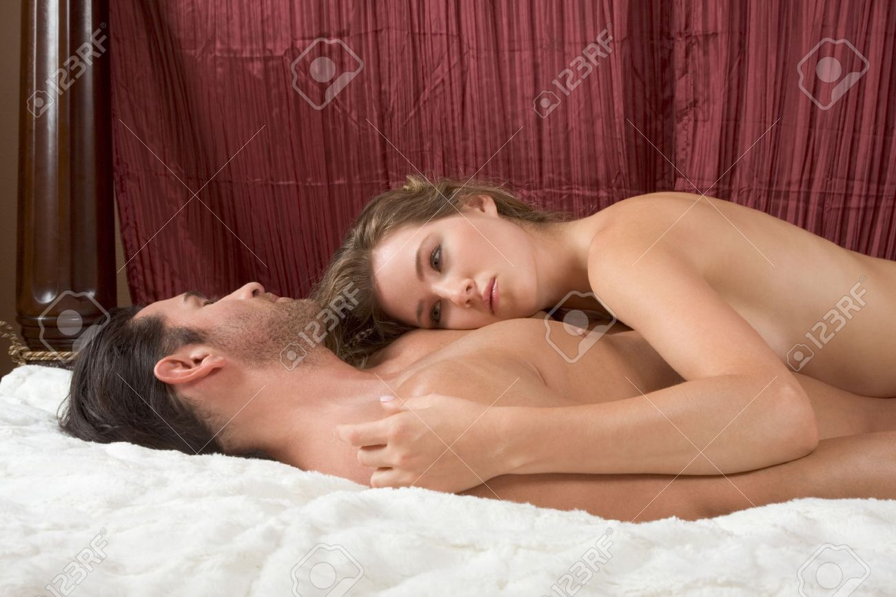 Young sexy naked heterosexual couple making love in bed Stock Photo - 13212059
