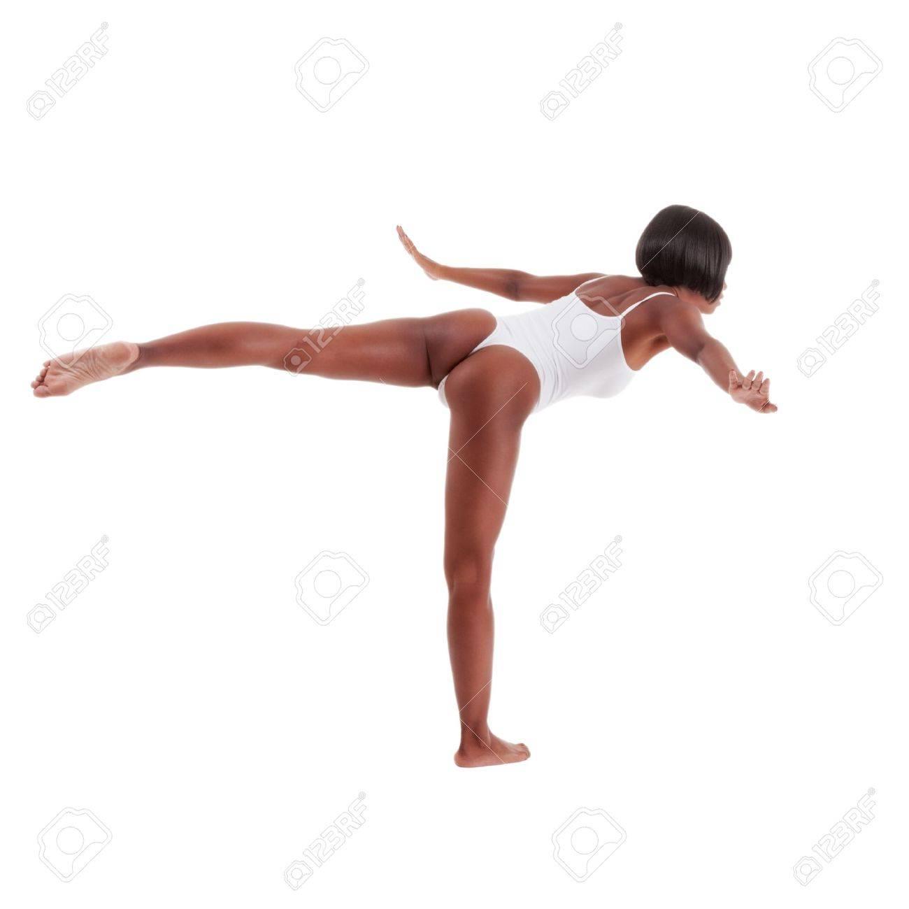 black ethnic African-American gymnastics ballet dancer woman in white one piece leotard Stock Photo - 20413654