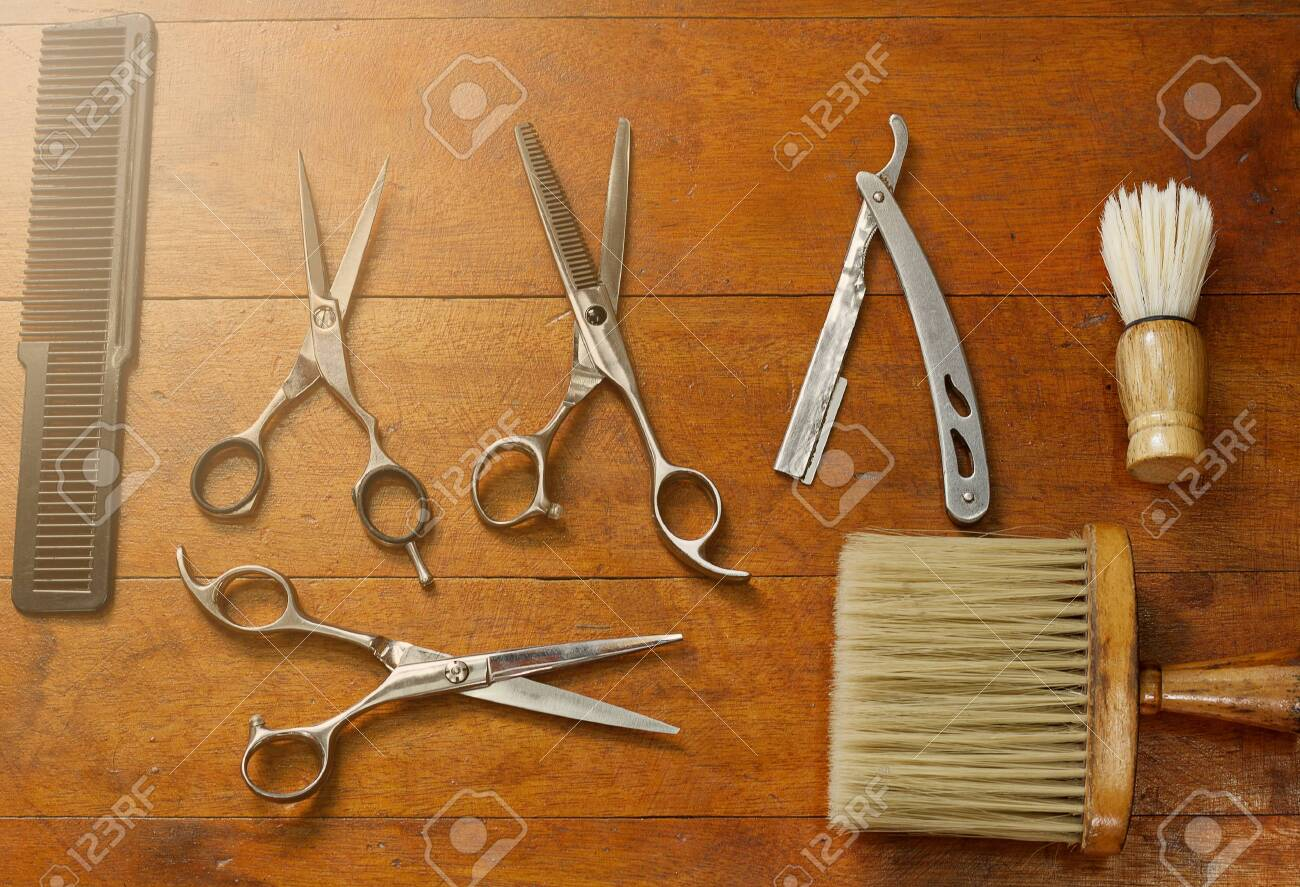 Equipment in the barber shop placed on wooden floors. - 121625250