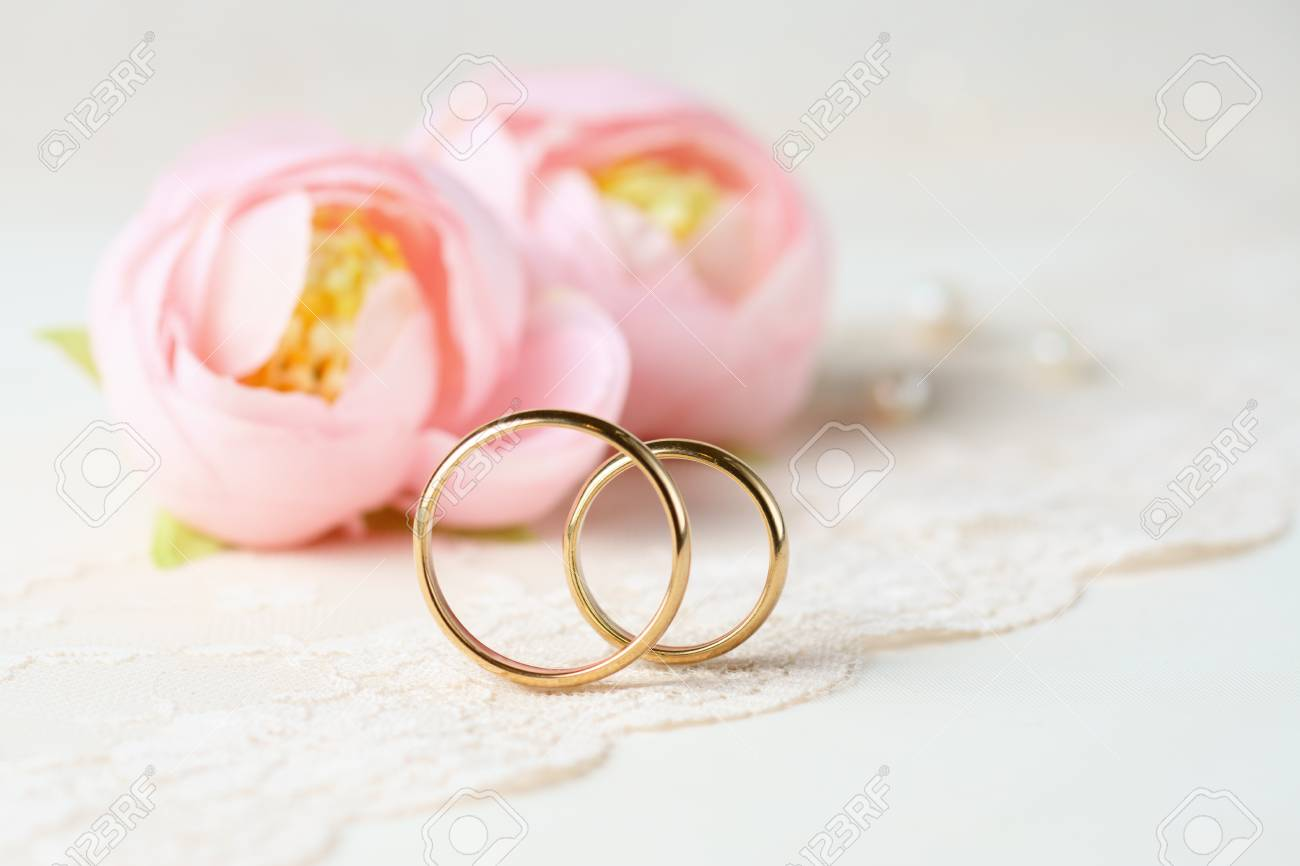 Wedding Rings, Flowers And Perls. Stock Photo, Picture And Royalty ...