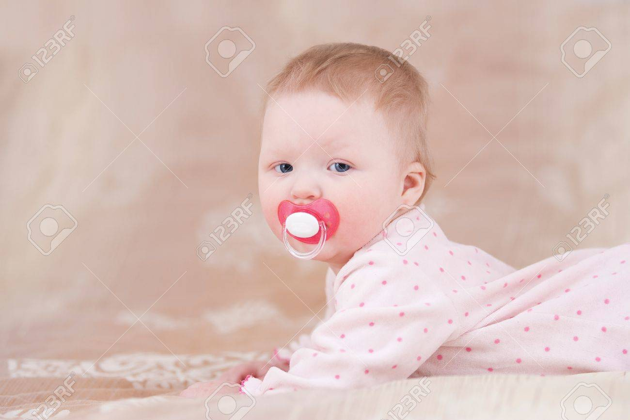 Cute baby with a pacifier Stock Photo - 18204601