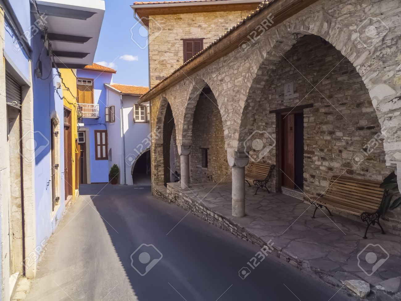 Narrow Street With Old Stone House With Pillars And Arches. Lefkara ...