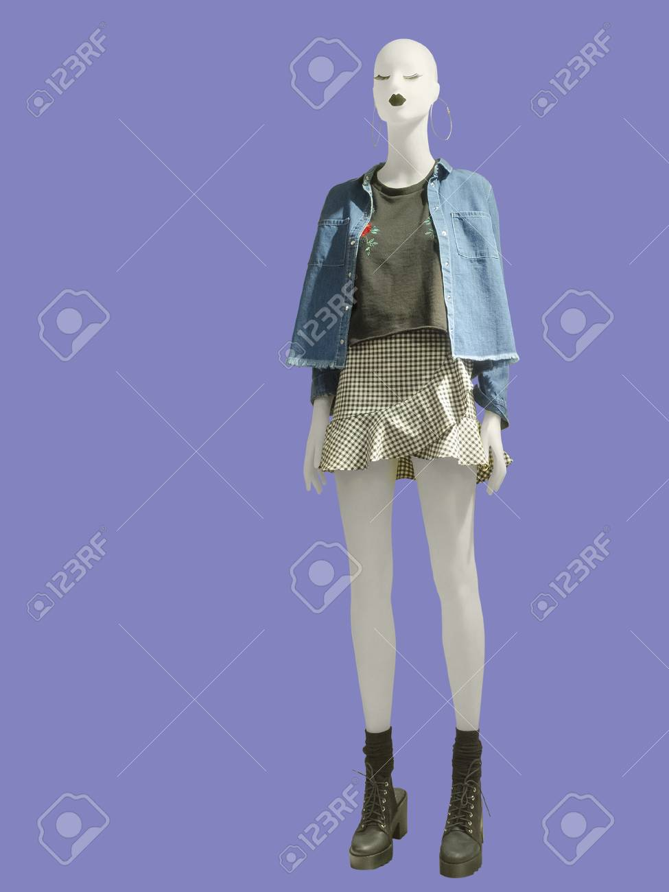 Full-length female mannequin dressed in casual clothes, isolated