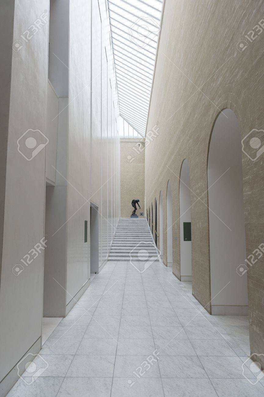 Tiled double volume interior passage with glass skylight letting in lots of daylight painted in neutral colours Stock Photo - 18832265