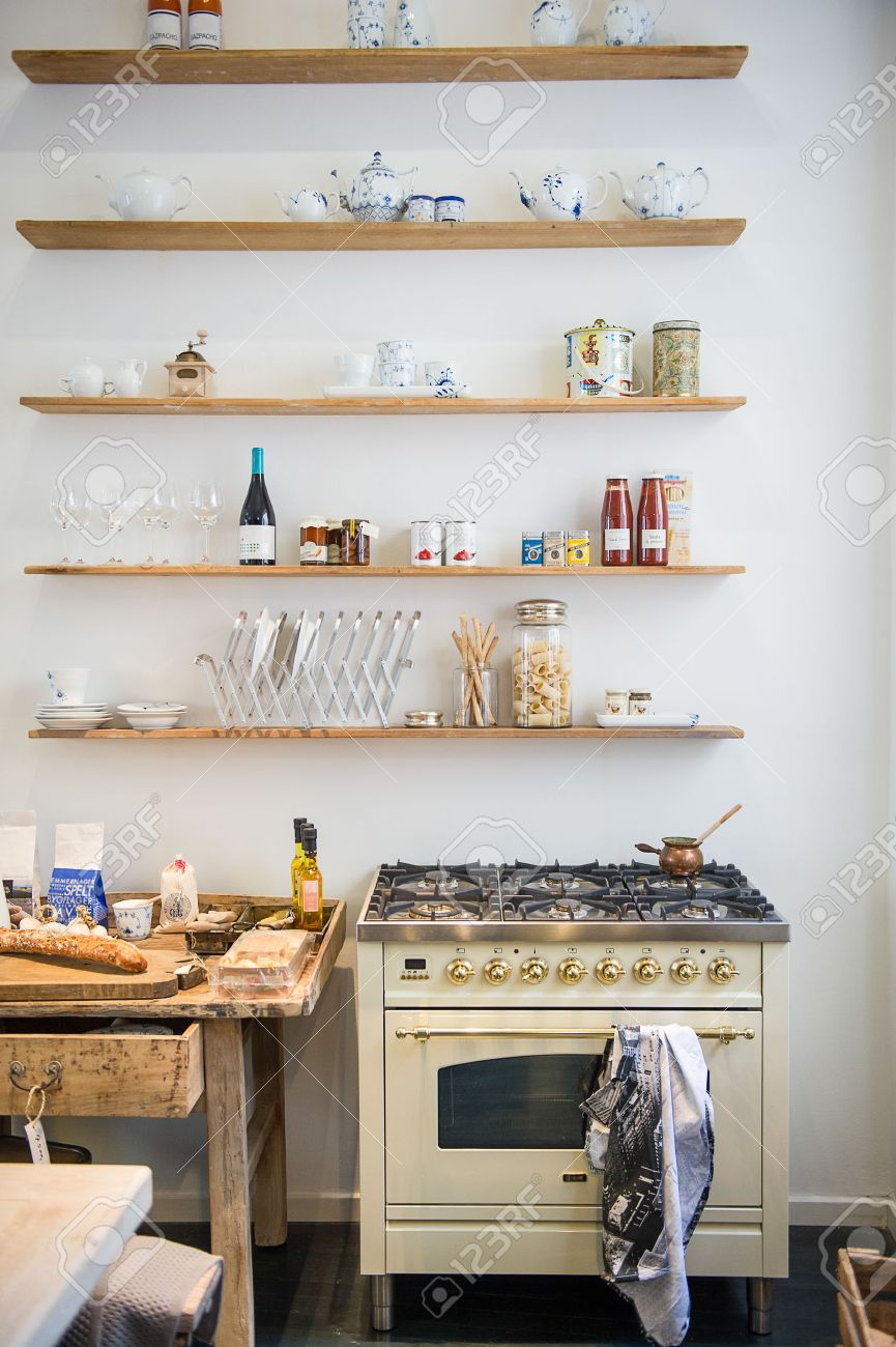 Small Appliances: Small Apartment Kitchenette Interior With A Modern Gas  Cooker And Simple Open Wall