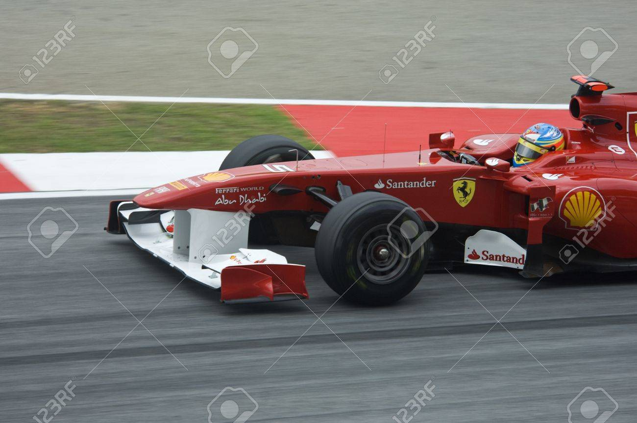 Sepang International Circuit, Malaysia - April 08th to 10th, 2011 – Fernando Alonso the driver for Scuderia Ferrari Formula One racing team testing the car during Petronas Malaysia Grand Prix 2011. Stock Photo - 9272019