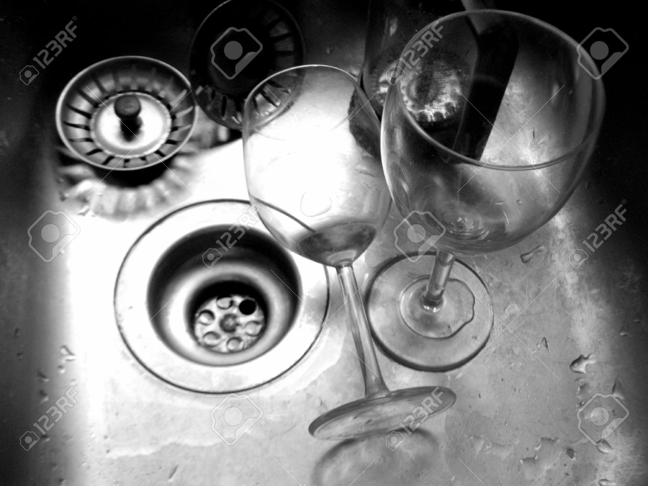 Mess In The Kitchen Sink And Wine Glasses Stock Photo, Picture And ...