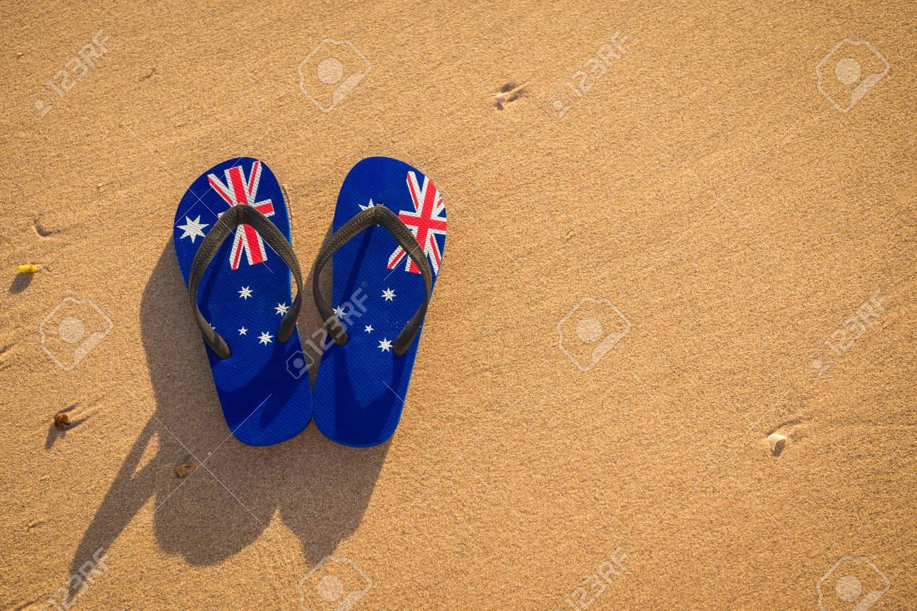 6e353efbffa9 Thongs With Australian Flag On The Beach At Sunset Stock Photo ...