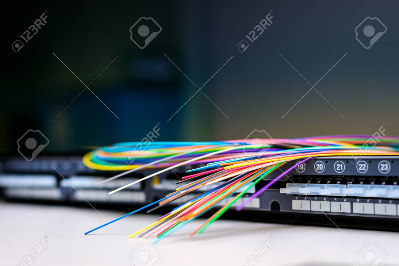 Fibre optic cables on top of patch distribution panel shelf for enterprise networking - 93640790