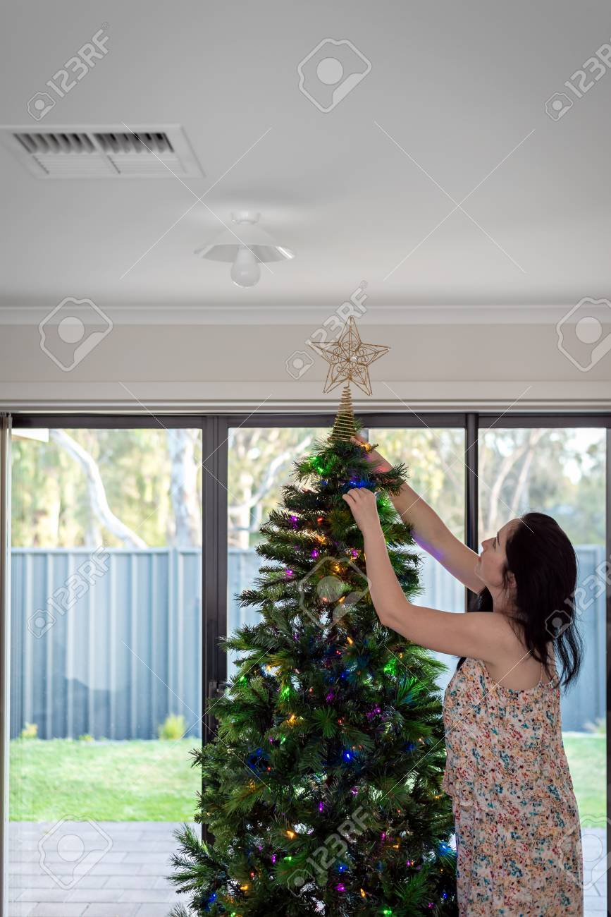 Australian Christmas Decorations.Woman Decorating Australian Christmas Tree In Her House South