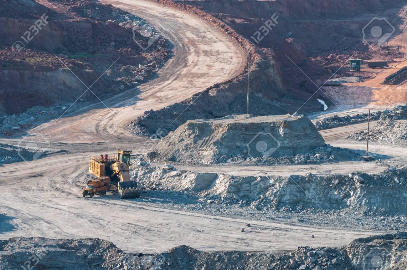 Yellow excavator loader lignite. Work in the mine. Stock Photo - 17358611