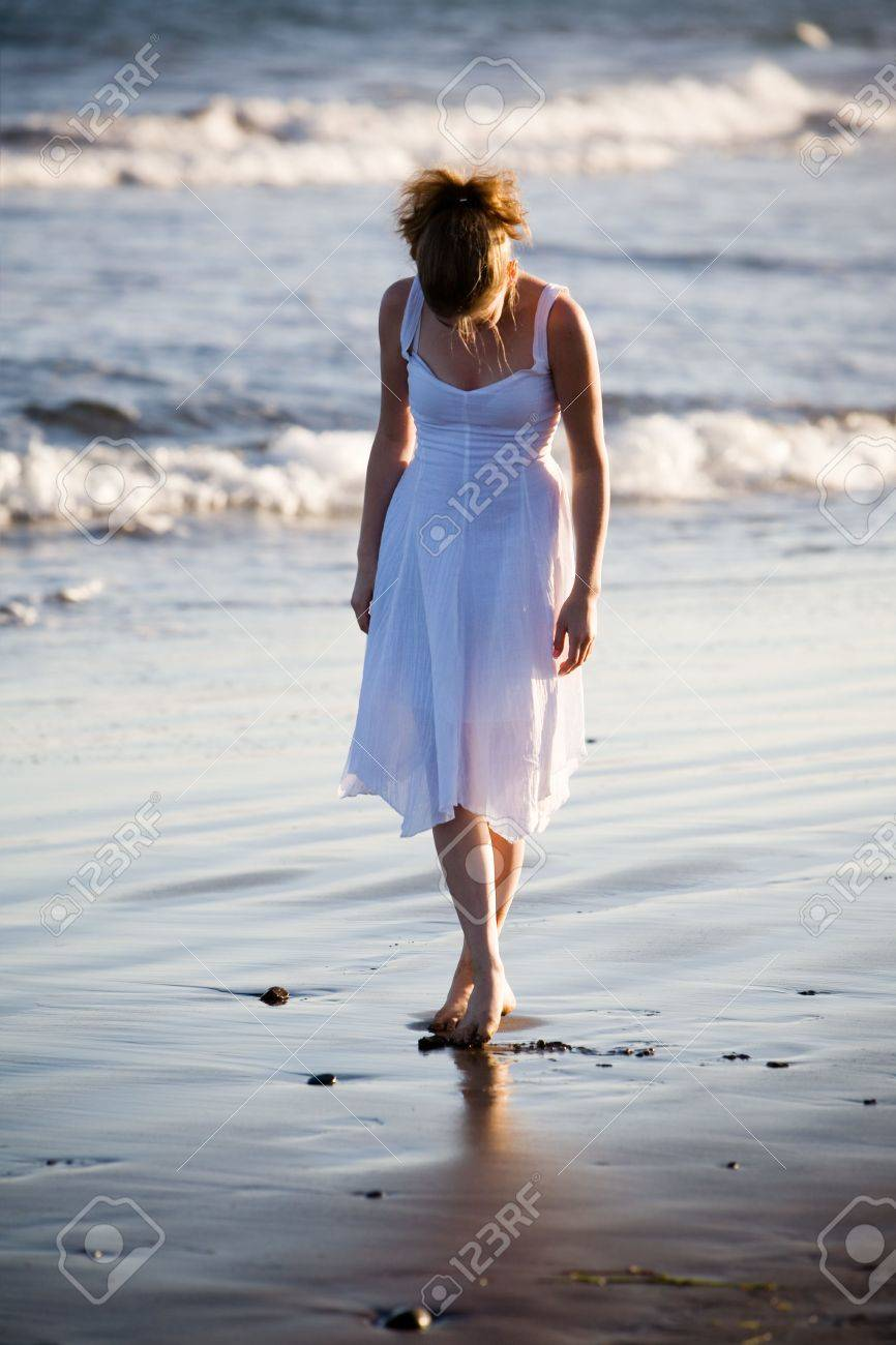 Woman walking on a beach royalty - Woman Walking On The Beach Stock Photo 4770872