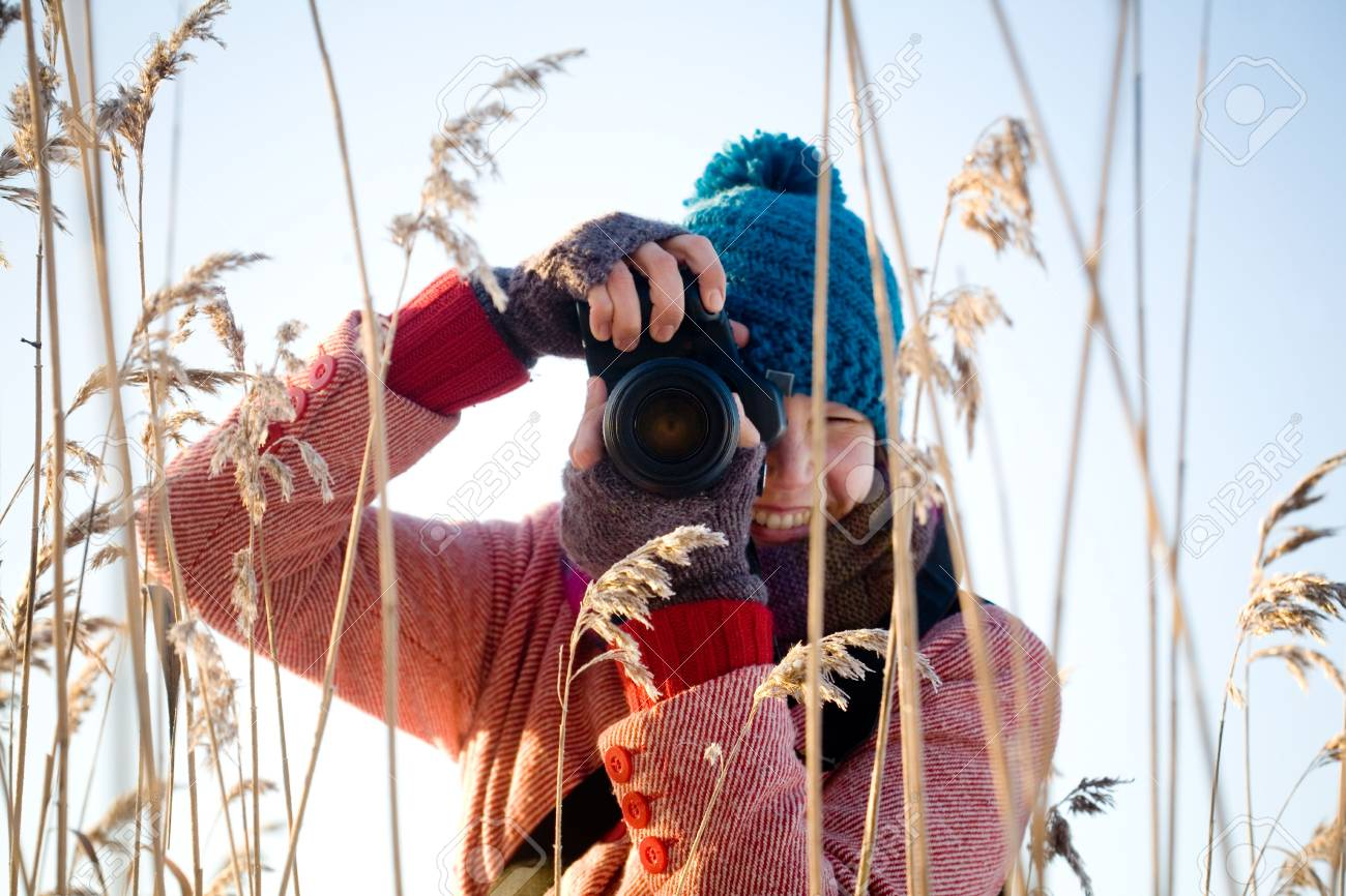 Young pretty woman taking nature pictures outdoors Stock Photo - 6249746