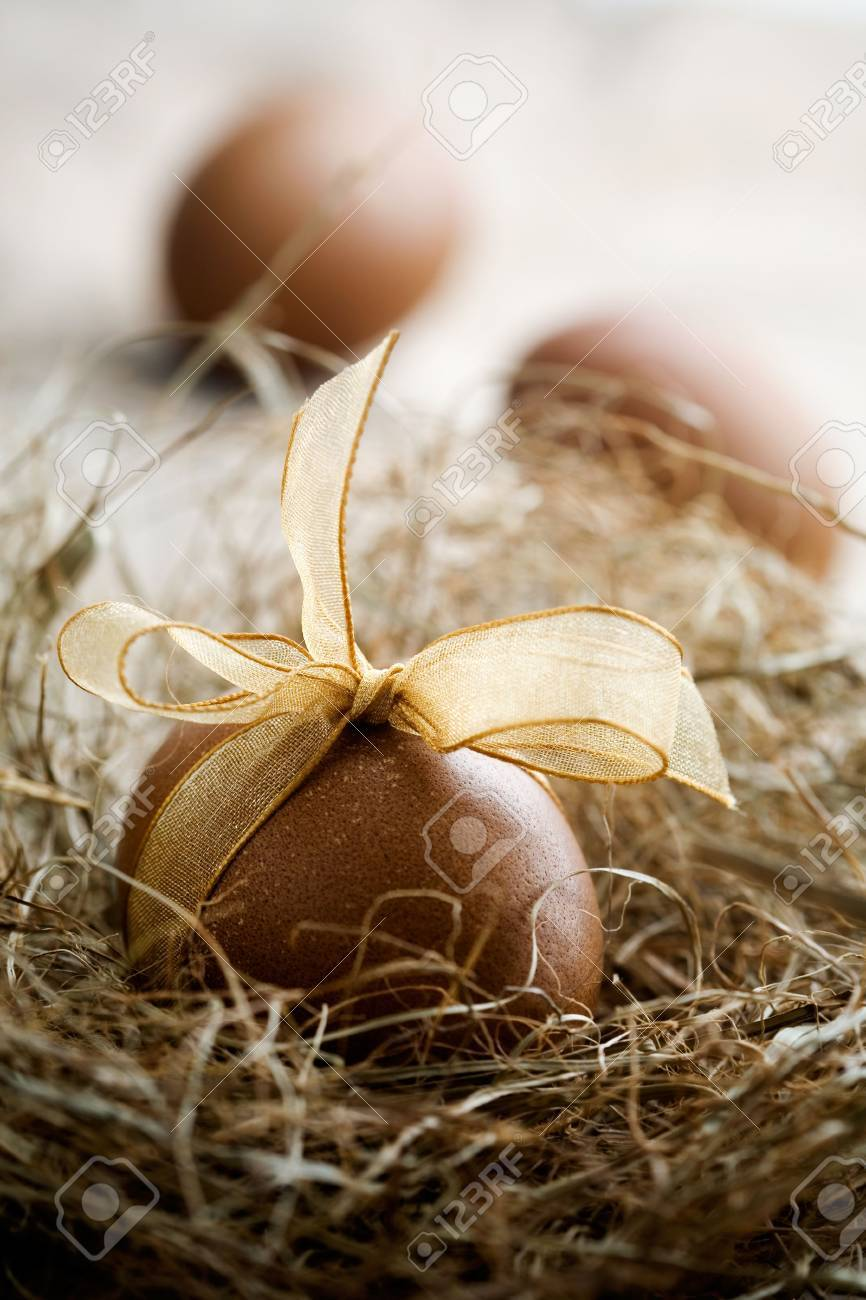 Brown easter egg with beautiful golden bow Stock Photo - 6416317