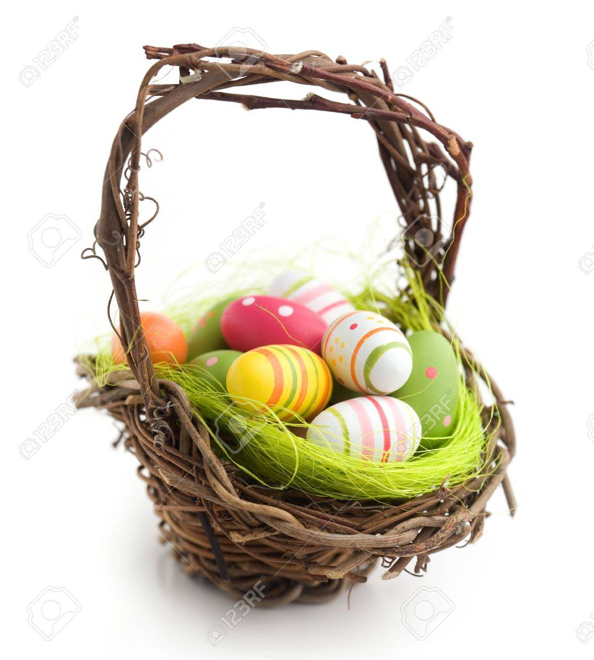 Colorful painted easter eggs in brown basket Stock Photo - 7745329