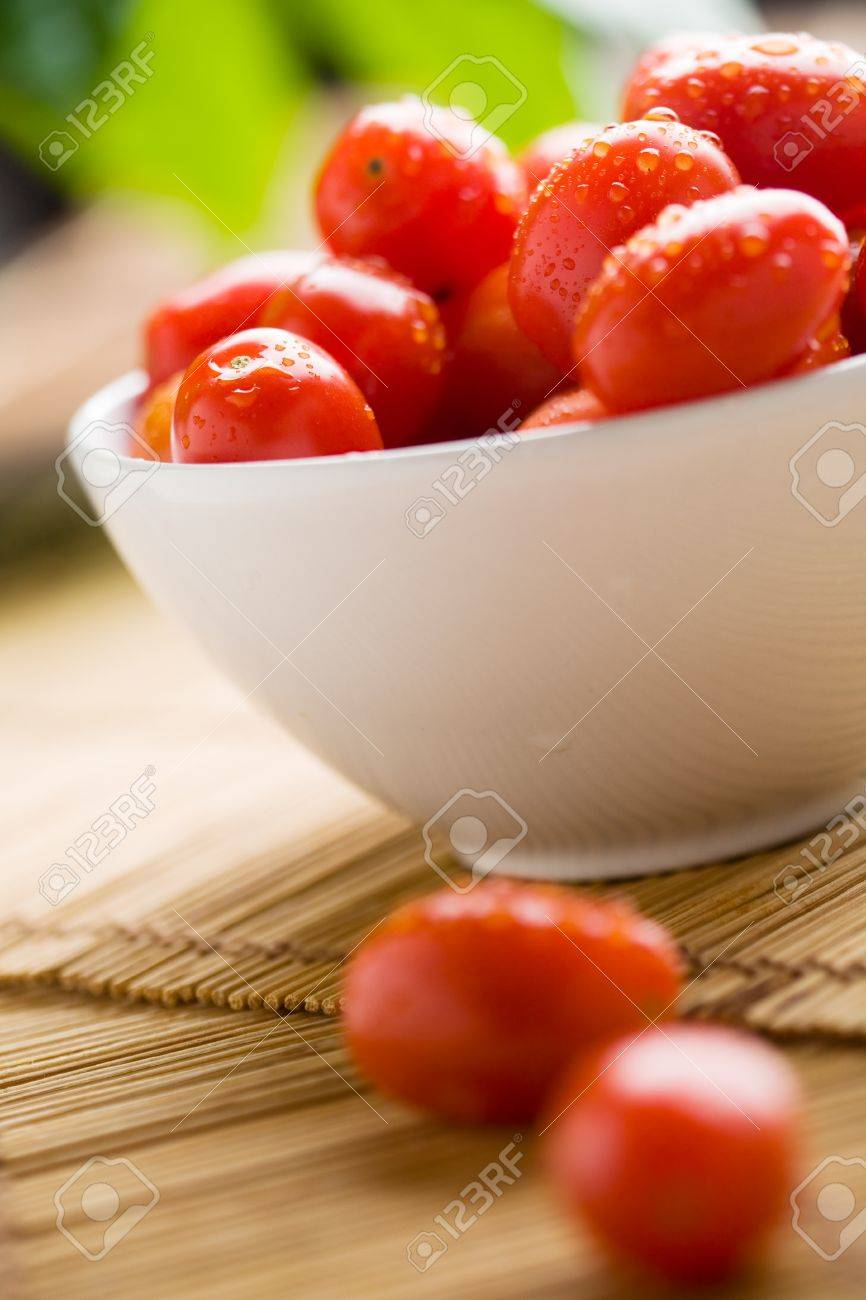 Close up of little tomatoes with water drops Stock Photo - 8740758