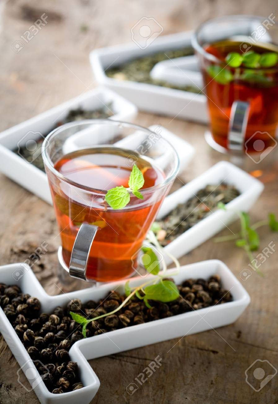 Tea leaves in letters and two cups of tea Stock Photo - 8858405