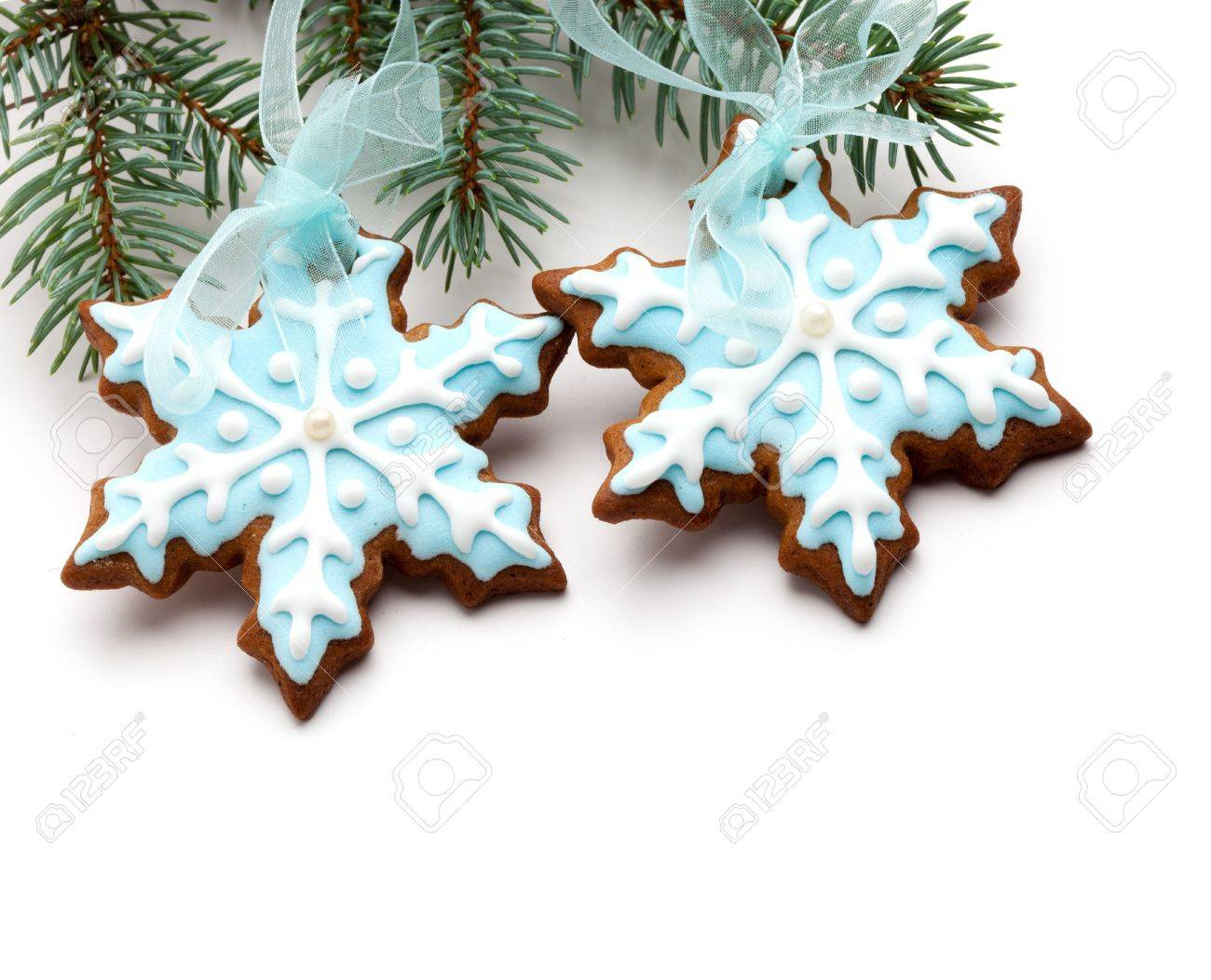 Closeup Of Snowflake Gingerbread Cookies Hanging From Tree