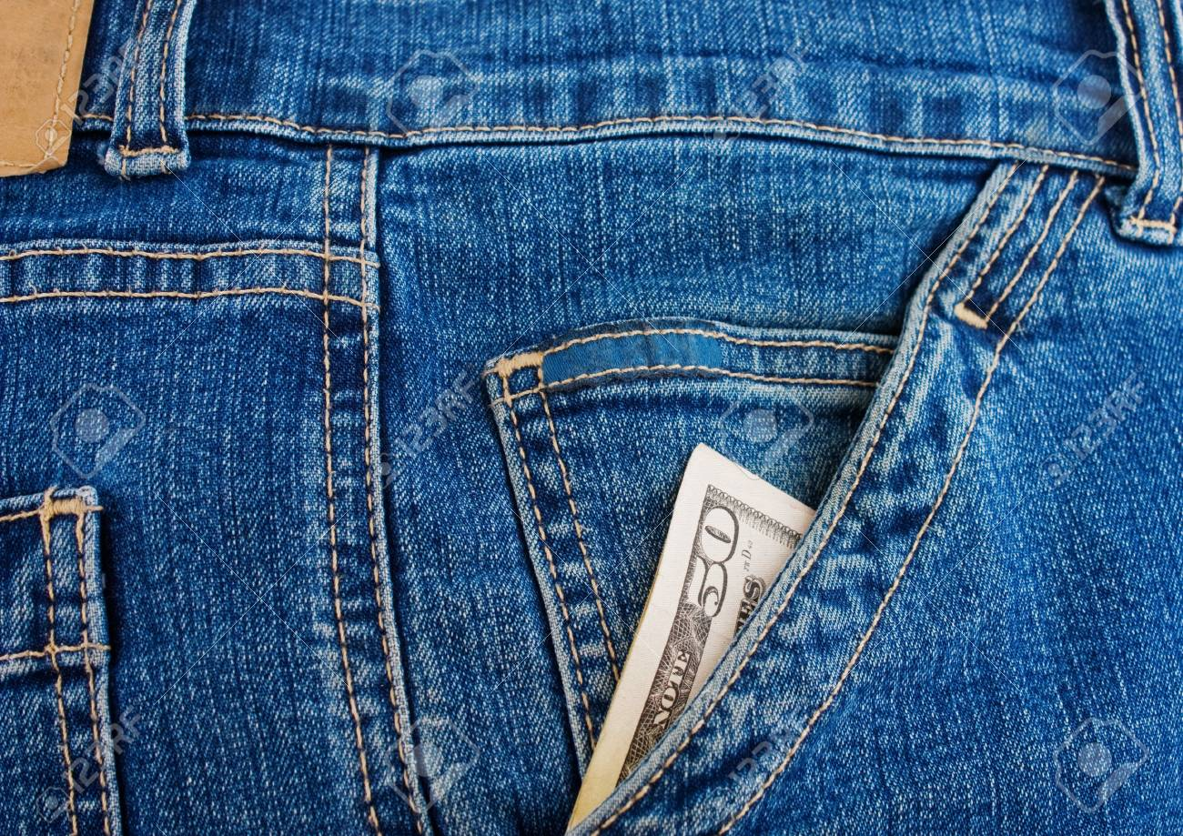 fifty dollars in the pocket of blue jeans Stock Photo - 16321791