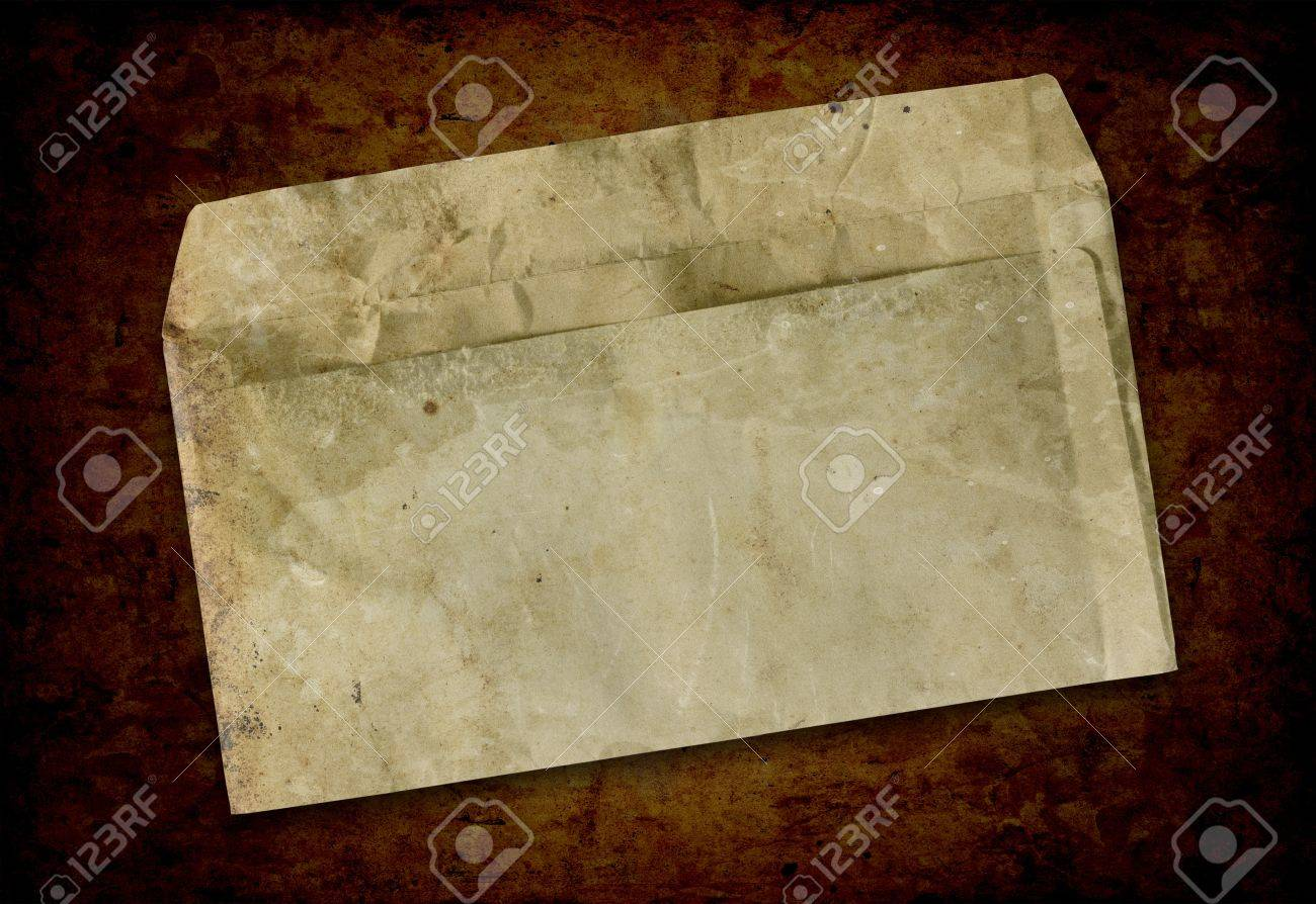 Vintage grungy old envelope. Dirt, folds and creases Stock Photo - 16487641