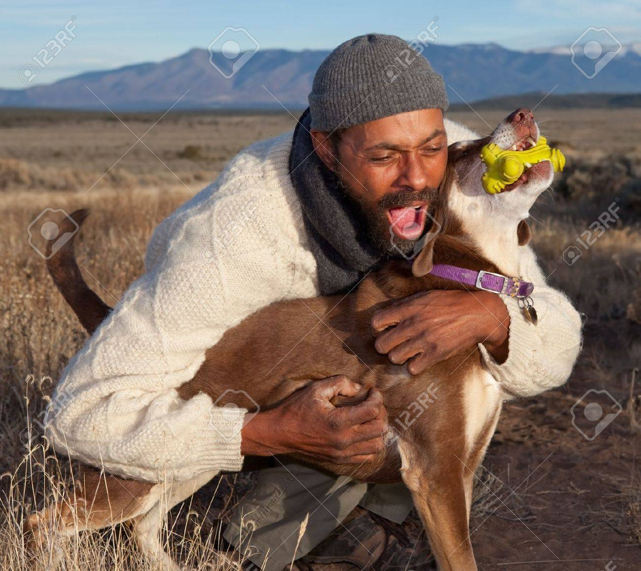 Man playing with his dog. Goofing, petting and howling. Stock Photo - 8398792