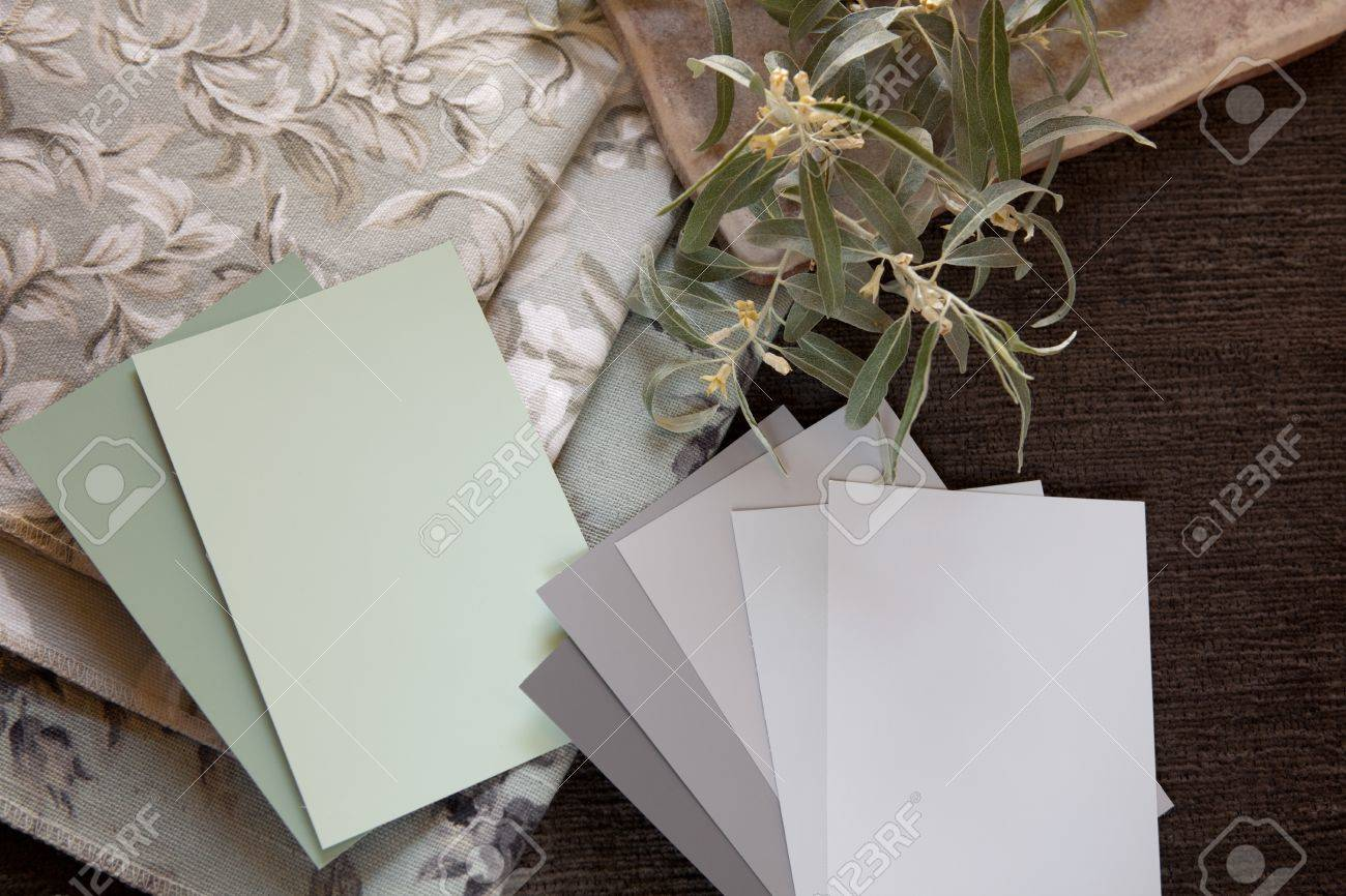 Light green and neutral gray paint color and fabric swatches  with a tile. Stock Photo - 9792341