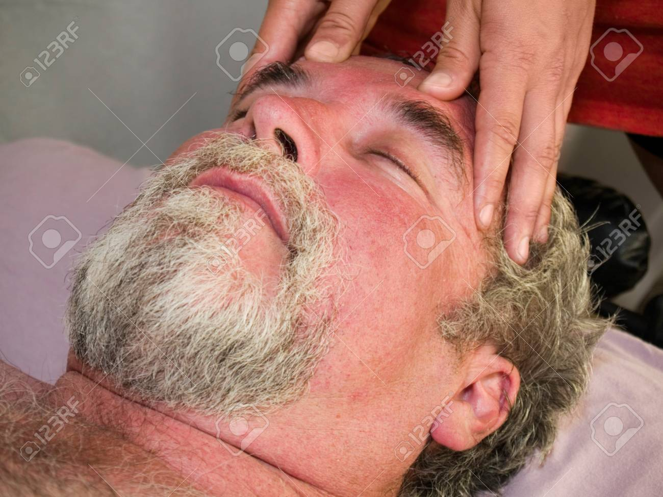 Man in his 50's getting a head massage Stock Photo - 11375377