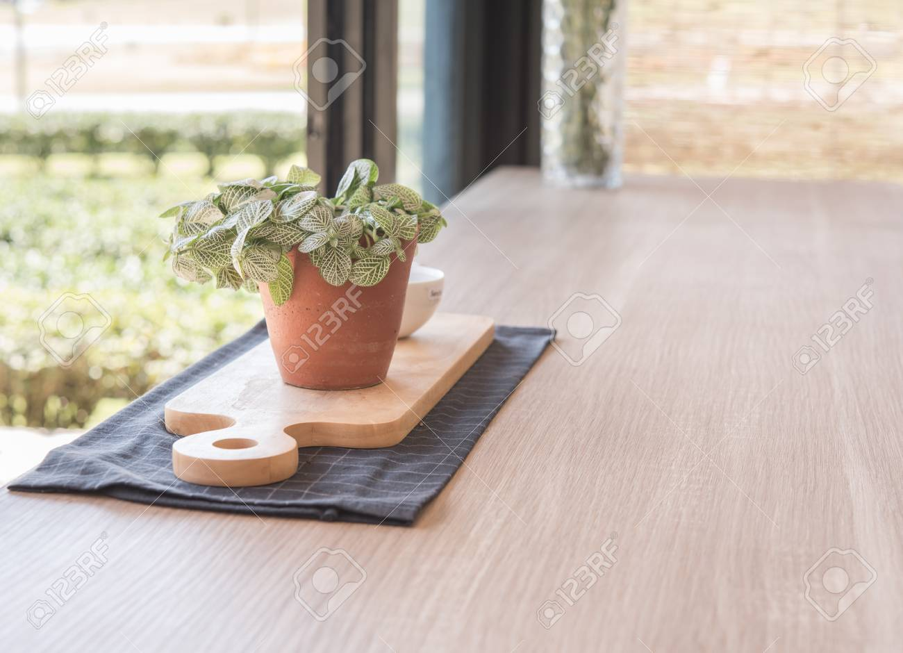 Jardiniere On Wooden Table In Front Of Blurred Background Stock ...